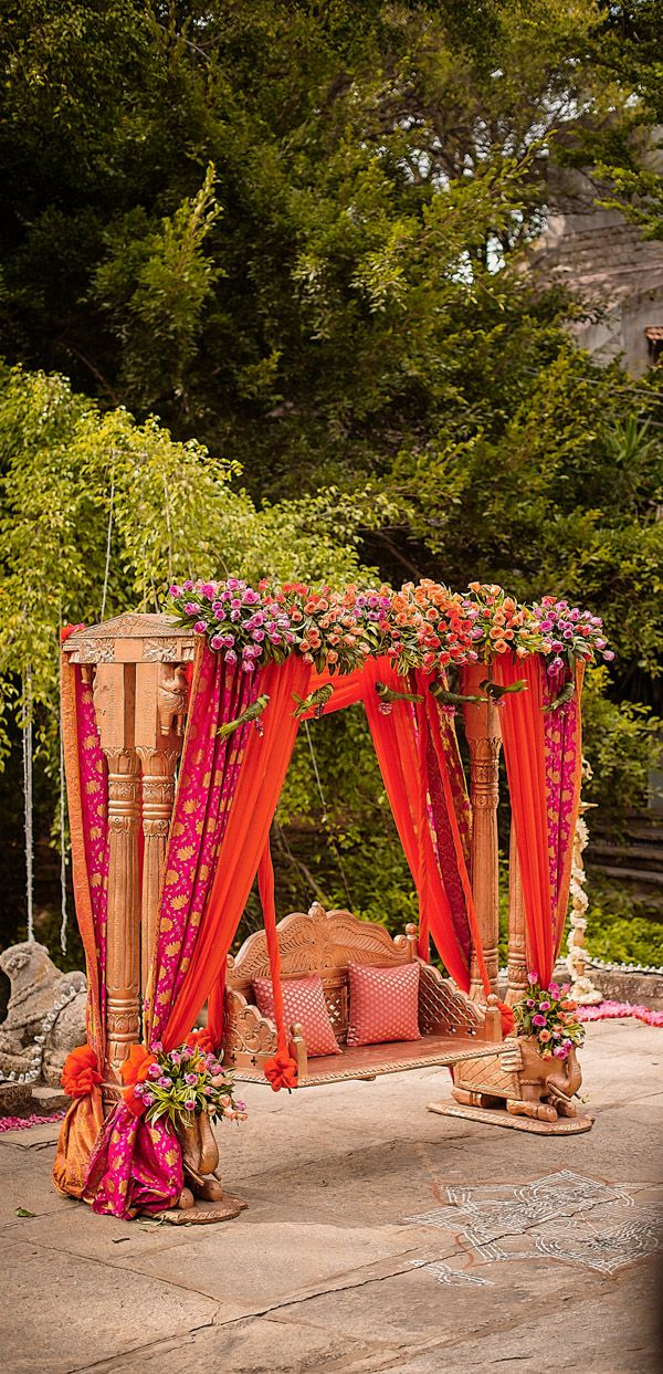 This decorated swing is perfect for an outdoor indian wedding event; Get some indian wedding color ideas too!