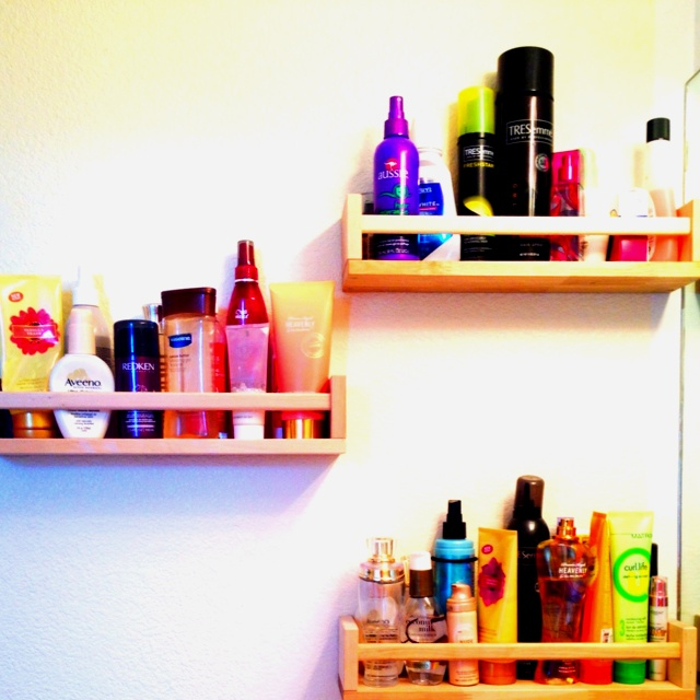 No cabinet space? We created our own=). IKEA spice racks mounted to the wall are a great and inexpensive way to organize a bathroom, utility room, kitchen, pantry etc. Only $3.99 per shelf at IKEA...paint or stain them to match any room! ~PR~
