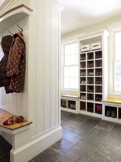 Traditional entry by Cushman Design Group :: [Ultimate organization in Vermont. A little simpler in style than the previous space, this entryway provides great storage inspiration. Shoe cubbies for everyone in the house keep this space clear and clutter under control.]