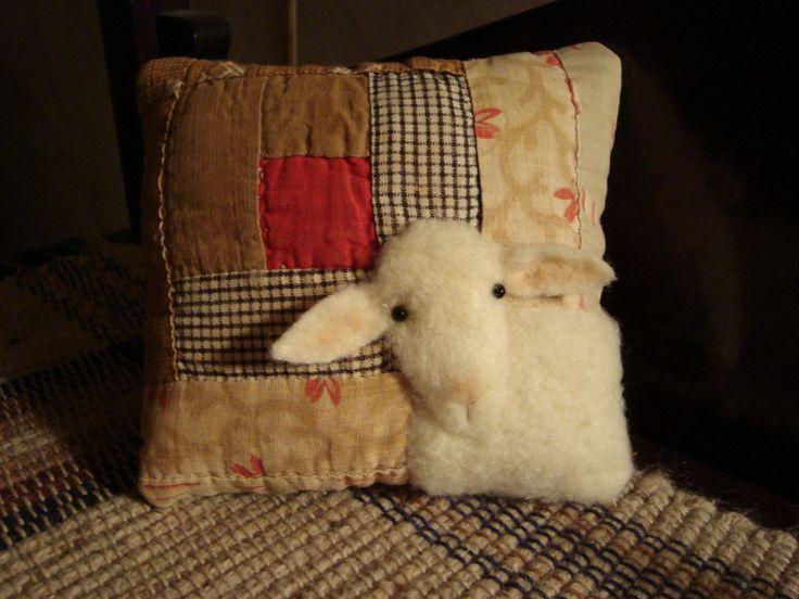 Antique Log Cabin quilt sheep pillow.
