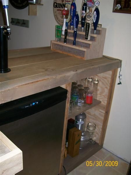 The Family Bar was built with old reclaimed barn boards.  The bars framework was built with 2 X 4 lumber that was laying around in my workshop waiting for it's next project.  Even some of...