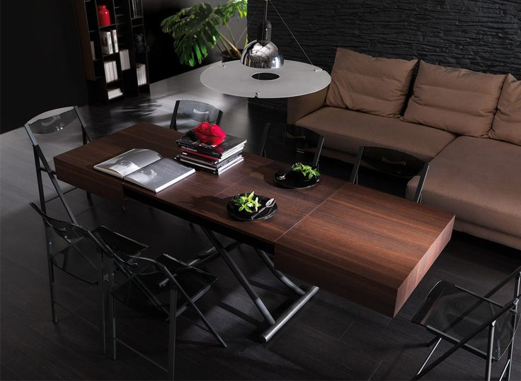 the cristallo table is a coffee table with a glass top and metal frame this space saving piece is adjustable to dining height