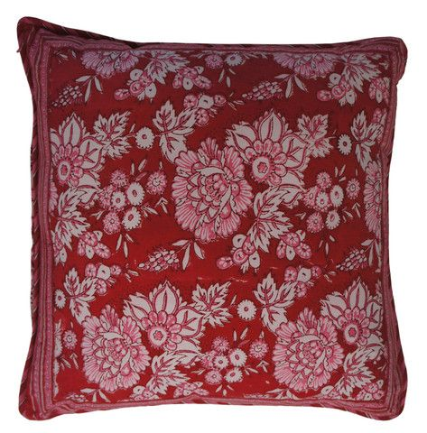 Printed natural cotton floral cushion in bright red and pink tones. The reverse has a complimenting repeated floral design in the same colours.  Hand block printed in India using ethical and environmentally friendly construction that preserves and celebrates traditional artisan skills.  100% natural cotton cover with NZ made Polyfill inner.  Dimensions: 45cm x 45cm