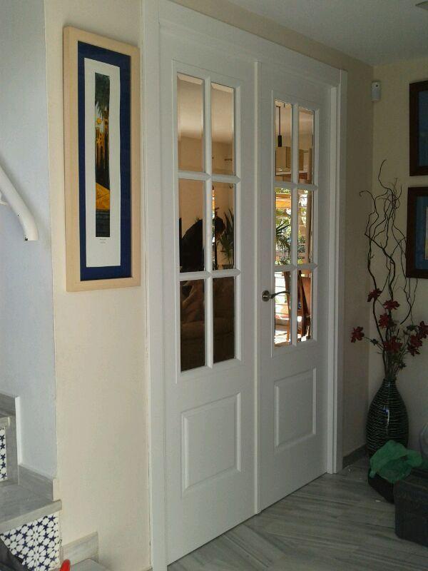 Millet lacada en blanco ev6 con cristal bisel transparente for Casas con puertas blancas