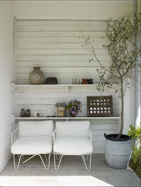 Wood slats outside add character to the sitting area right next to the house.