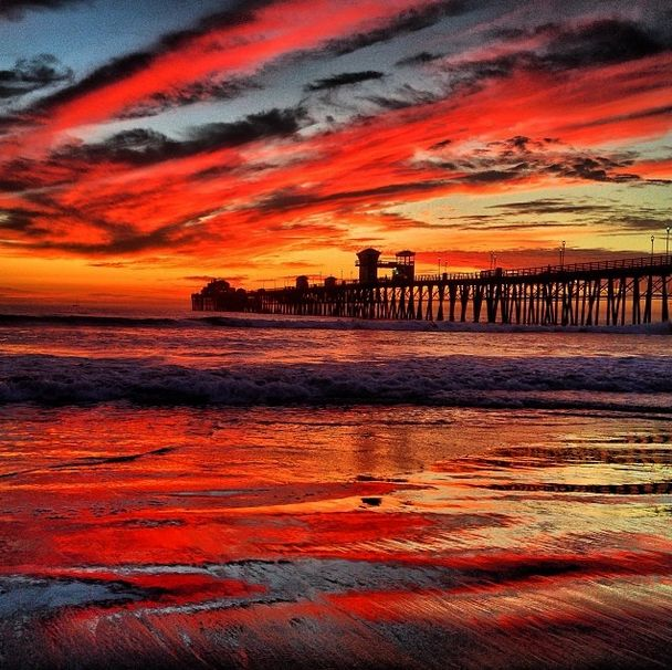 Fiery sky in Oceanside, California. Photo by crusephoto on Instagram. | Sky | Amazing | Beach | Ocean | Reflection | Sunset | Color | Pier