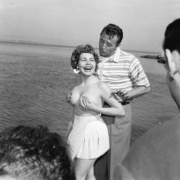 B-list movie actress Simone Silva caused controversy when she posed topless with actor and singer Robert Mitchum at the 7th Cannes International Film Festival back in 1954. The star was later asked to leave the festival.