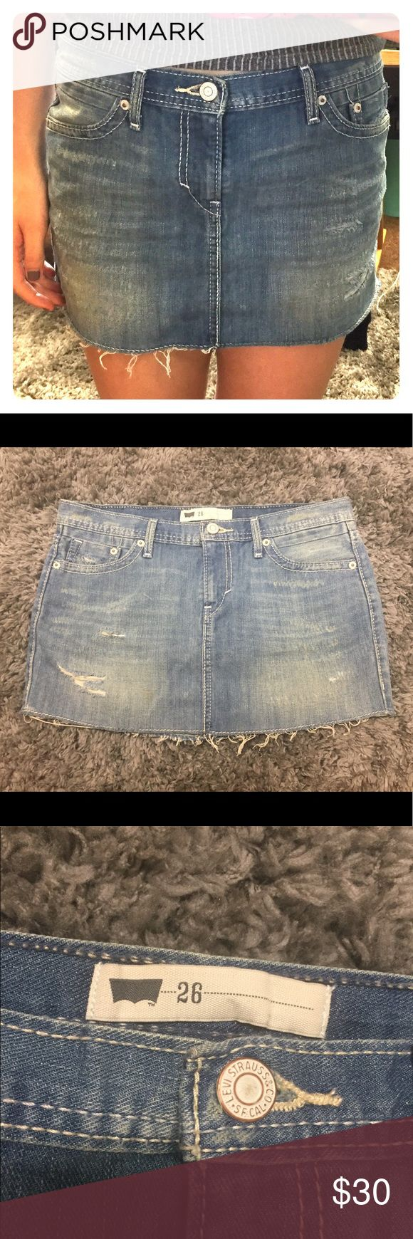 LEVI'S denim mini skirt vintage style Condition: perfect! Worn only once, didn't suit my style. Zipper, seams, distressed detailing is all in perfect condition Features: vintage look with distressed detailing Color: lightwash denim Fit: hugs hips comfortably Can be worn edgy or girly or anywhere in between! Levi's Skirts Mini