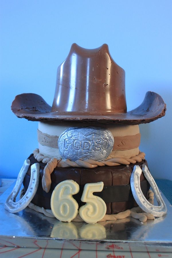 I made this for my Father In Law's 65th Birthday. He decided he wanted a Western themed party as he does Rodeos in NZ. So I surprised him with this cake. The hat is made from milk chocolate and I used a cowboy hat bowl as the mold. The middle tier is white chocolate banana mud cake and the bottom tier is chocolate mud cake. A big thank you Kello on this site for the idea.