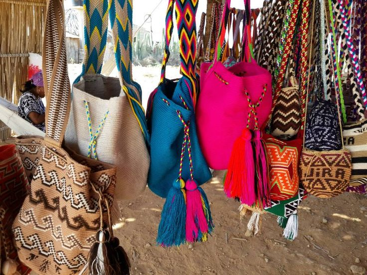 Wayuu bags. Aboriginal people weaving the wayuu bags in LA Guajira Colombia. Each artist takes around 2 to 3 weeks to weave it and each bag reflects her creativity, inspiration and thoughts.