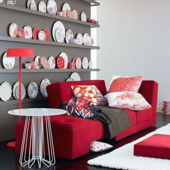 Shining-White-Living-Area-with-Cute-Red-Couch-and-Plate-Collections