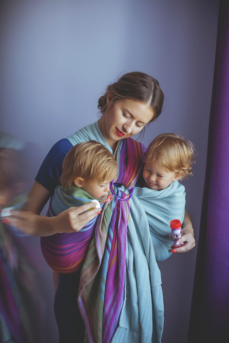 Tandem babywearing of my boy and girl twins. Check my blog for details