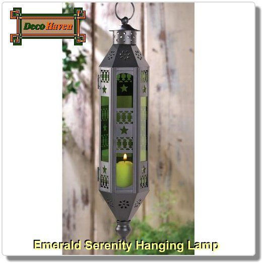 Emerald Serenity Hanging Lamp - Tranquil shades of green add a feeling of serenity, as countless intricate cutouts cast an enchanting candlelit glow. With a uniquely slender shape, this lamp bestows an exotic flair most anywhere!