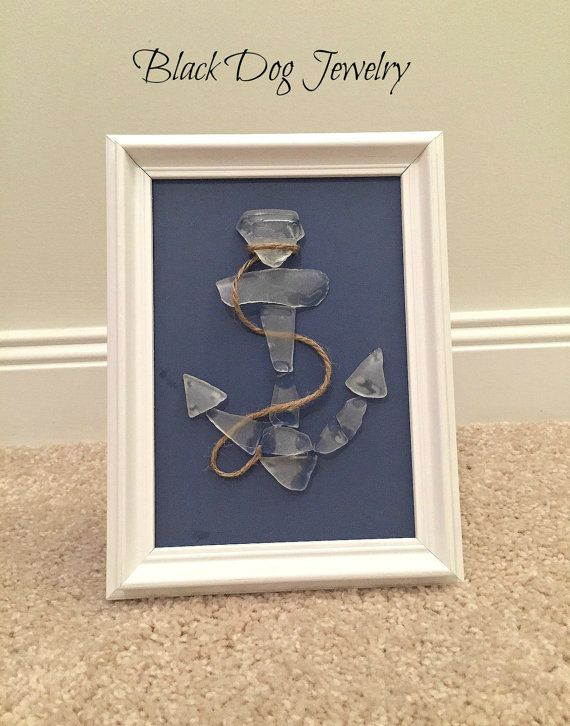 Sold! This anchor sea glass art features genuine sea glass that was found on the beaches of the Treasure Coast, Florida.  11 pieces of white