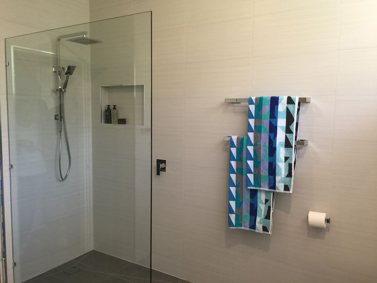 This full bathroom renovation transformed the room into a modern masterpiece. Great interior design with all the latest bathroom products from Highgrove Bathrooms. Frameless Shower Panels with Integrated Shower Rail and beautiful bathroom accessories