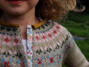 cardigan porcelaine by Sandrine and Co...love the Liberty-print button tape detail-really great idea...