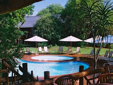 2 Nights at Protea Hotel Kruger Gate  Situated only 100 metres from the Kruger gate entrance to the Kruger National Park, 30 minutes drive from Hazyview or an easy 5 hour drive from Johannesburg and 85km from Kruger Mpumalanga International Airport. Each of the comfortably appointed 96 luxury en-suite bedrooms and 7 six-sleeper fully equipped self-catering units ensure guests feel part of the bush environment.   2 nights R 3,028 pps Validity: 27 March to 22 April 2015  Ref: TH539700  Self…