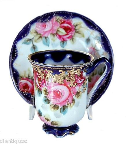 Pretty! Antique Nippon roses cup & saucer.