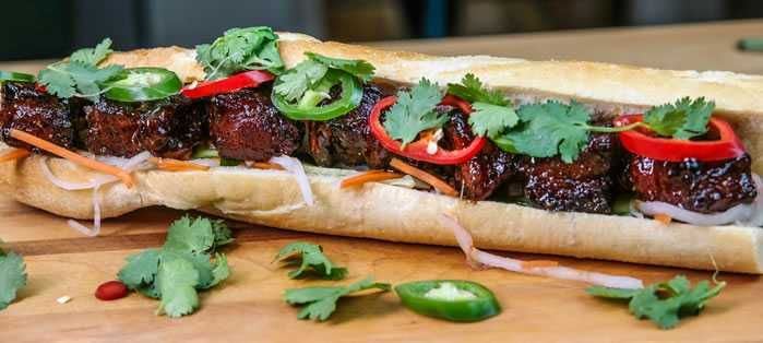 Smoked Pork Belly Bahn Mi –   This barbecue version of the classic Vietnamese sub is sure to make your knees buckle.