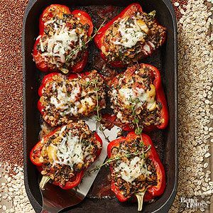 Peppers Stuffed with Quinoa and Spinach by bhg: Pack red sweet peppers with whole grains, veggies, and gooey cheese for a healthy vegetarian dinner. #Stuffed_Peppers #Quinoa #Spinach #Healthy