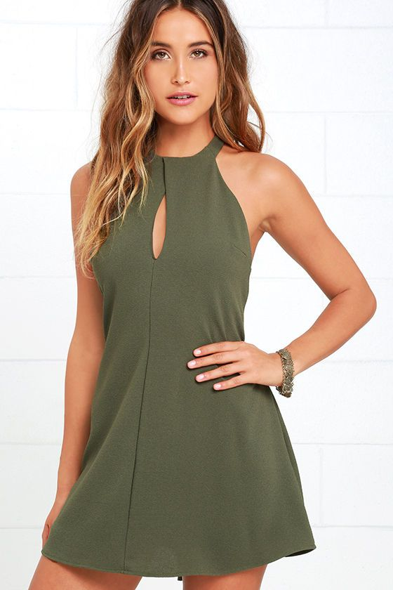 Put them under a spell with your irresistible charm, and the Could It Be Magic Olive Green Dress! Textured, woven fabric forms a buttoning, halter neckline with keyhole cutout above a darted, sheath bodice. Racerback has a unique draped look.