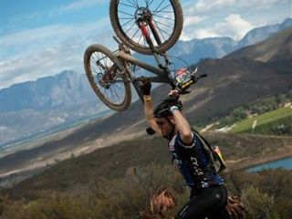 A rider celebrates reaching the top of a climb during the (time trial) stage five of the 2010 Absa Cape Epic Mountain Bike stage held in Wor...