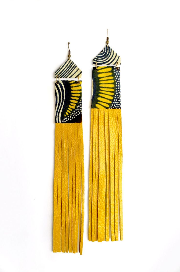 Embrace your Bohemian side with these free-flowing fringe earrings made with a designer African Ankara print fabric, and genuine leather.  They are definitely a bold, statement accessory that can be casual or dressed up.  This extra long, 8   3/4 inch pair hang by antique copper earwires.  Fabric i