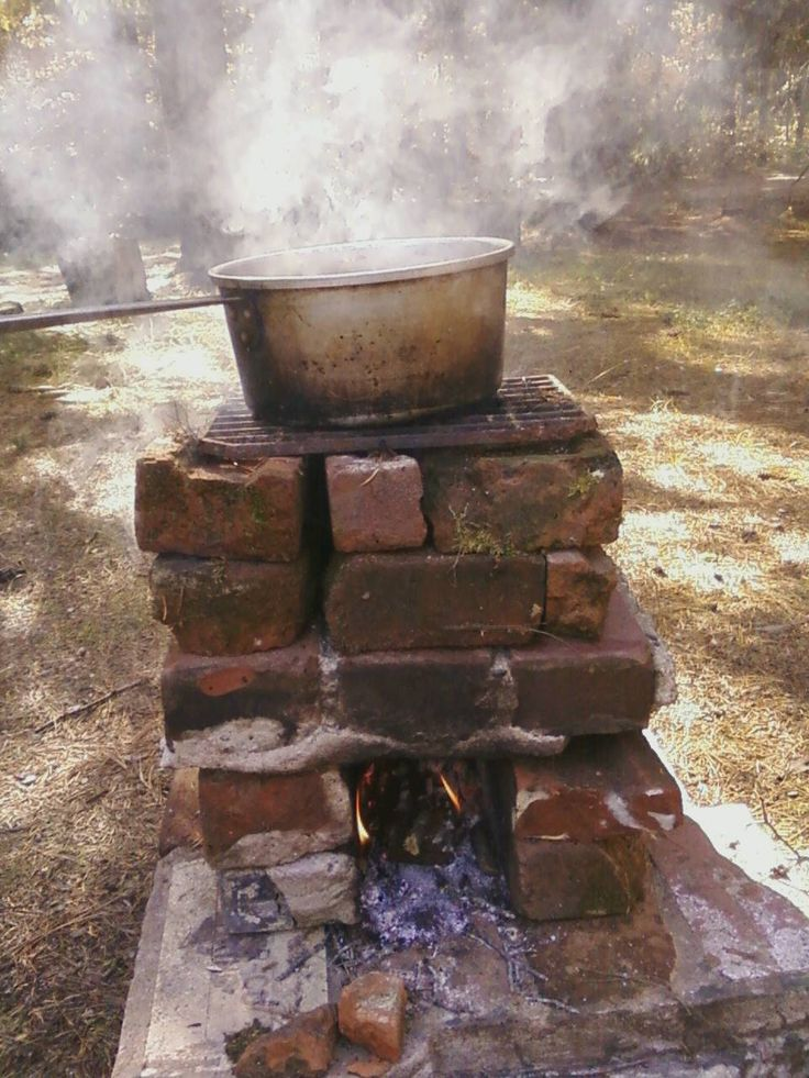 I've wanted to make a rocket stove for a long time and just saw one made of bricks on Pinterest. So, I made this out of old broken bricks we had pulled up from a patio. I used very few little sticks and took well water (about 40 degrees F) to boiling in 25 minutes. Not bad.
