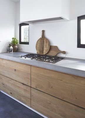 Kitchen by Molitli | Country Minimalist with grey counters, wood cabinets & black frame windows