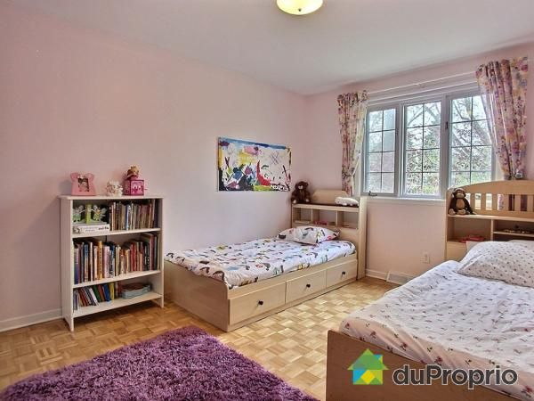 Shared pink bedroom for 2 girls, with over-sized homemade abstract art. Captain beds for extra storage!