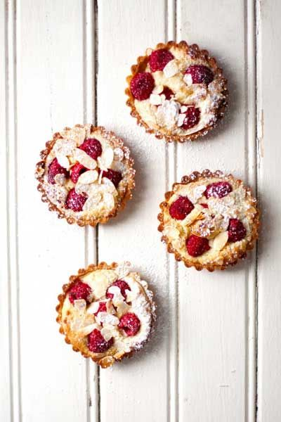 This recipe for Raspberry Frangipane Tarts is for the love of rasberries, tarts and sweet things!