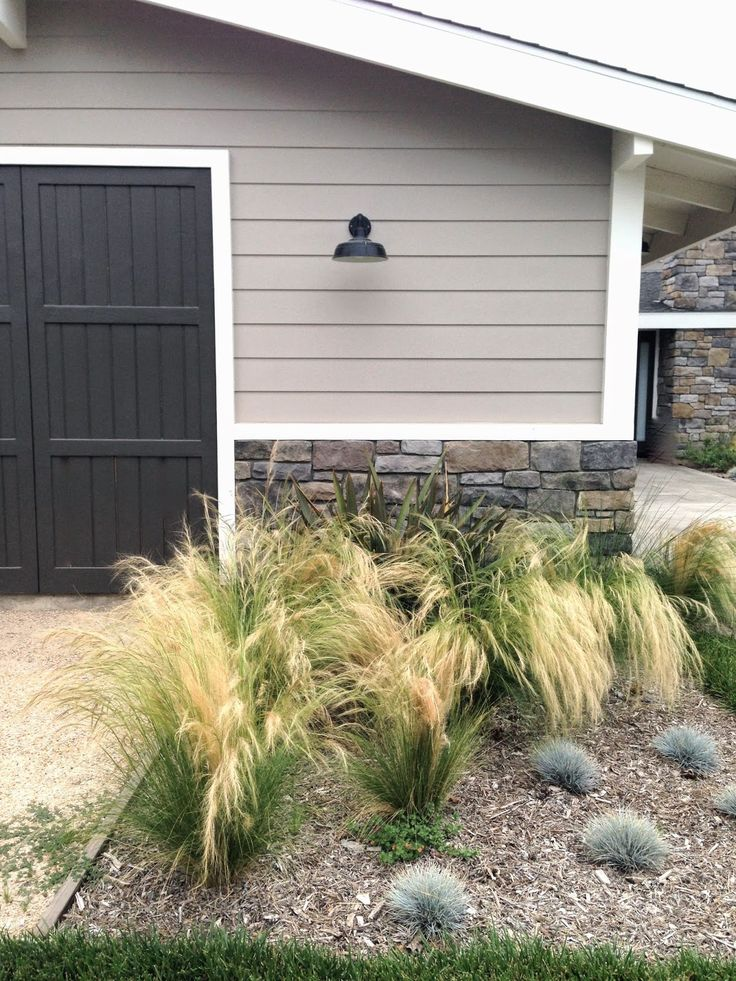 Great color combo for a home or garage. The color seem to have flow directly from the stone. The horizontal siding is contrasted by the vertical on the garage doors.