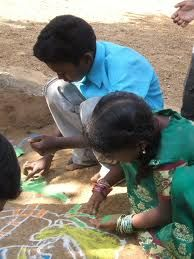 Kids drawing kolams