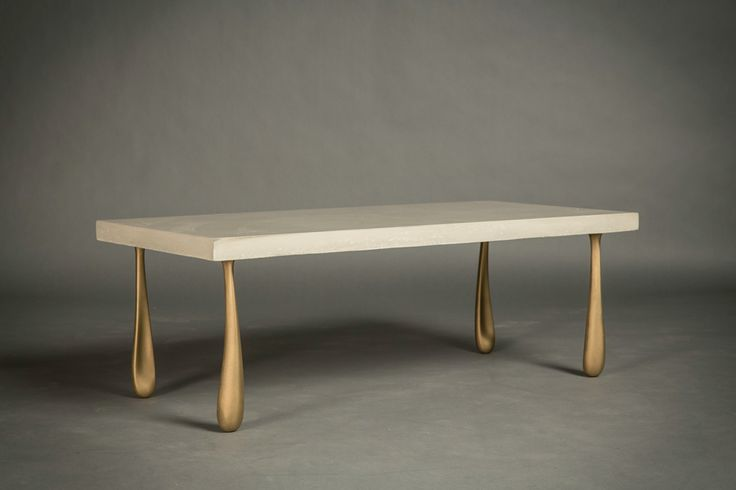 Coffee Table with solid cast bronze legs and an Engineered Cementitious Composite top.