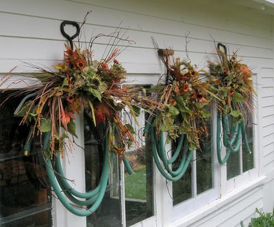 I've seen this done with lime greem hose and zinnias.  Great summer look.