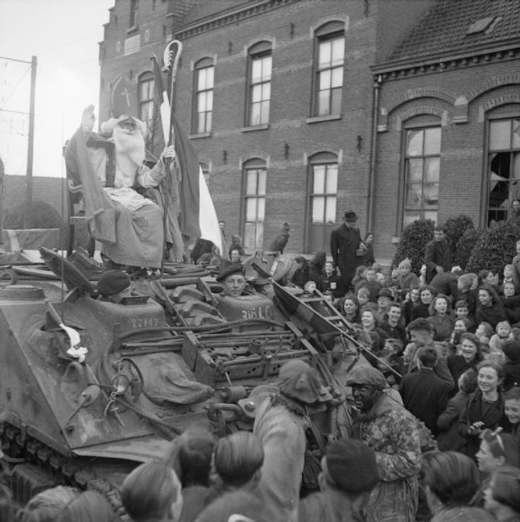 St Nicholas arrives on a Sherman ARV as part of St. Nicholas Day celebrations in Rucphen, near Roosendaal in The Netherlands, 6 December 1944.