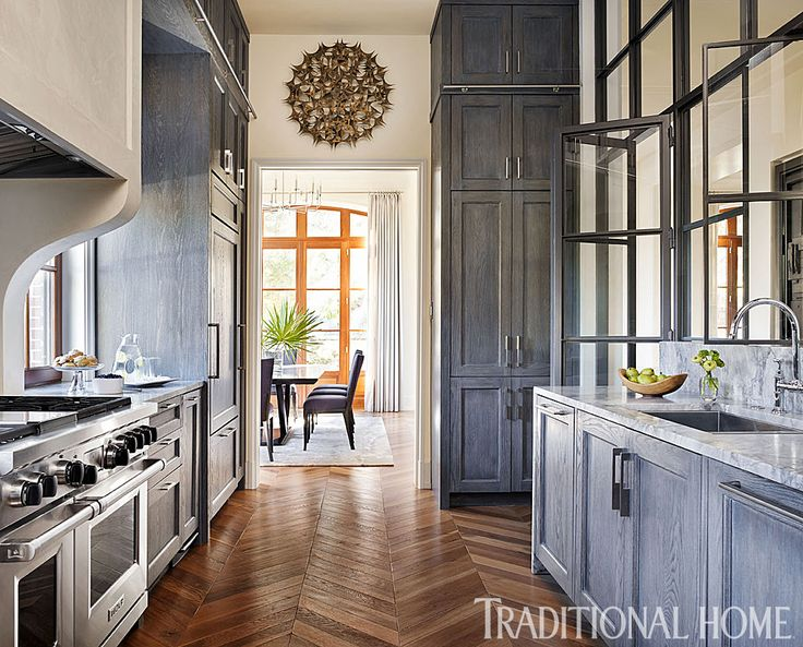Lime washed oak cabinets extend to the ceiling to maximize storage in this smart kitchen - Smart kitchen furniture ...
