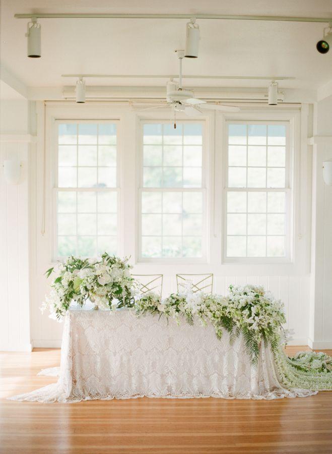 Elegant greenery wedding decor: http://www.stylemepretty.com/2017/04/21/an-elegant-island-style-elopement/ Photography: Aria Studios - http://www.ariastudios.com/