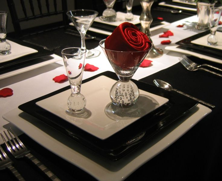 Black white and red table setting 1 - red napkin rolled like a rose and placed in a sphere martini glass