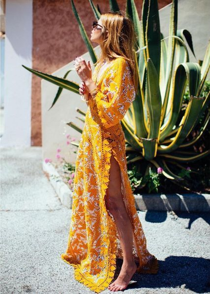 cool Yellow maxi dress. so pretty yet sexy!! i love how it shows leg and the lace tri...