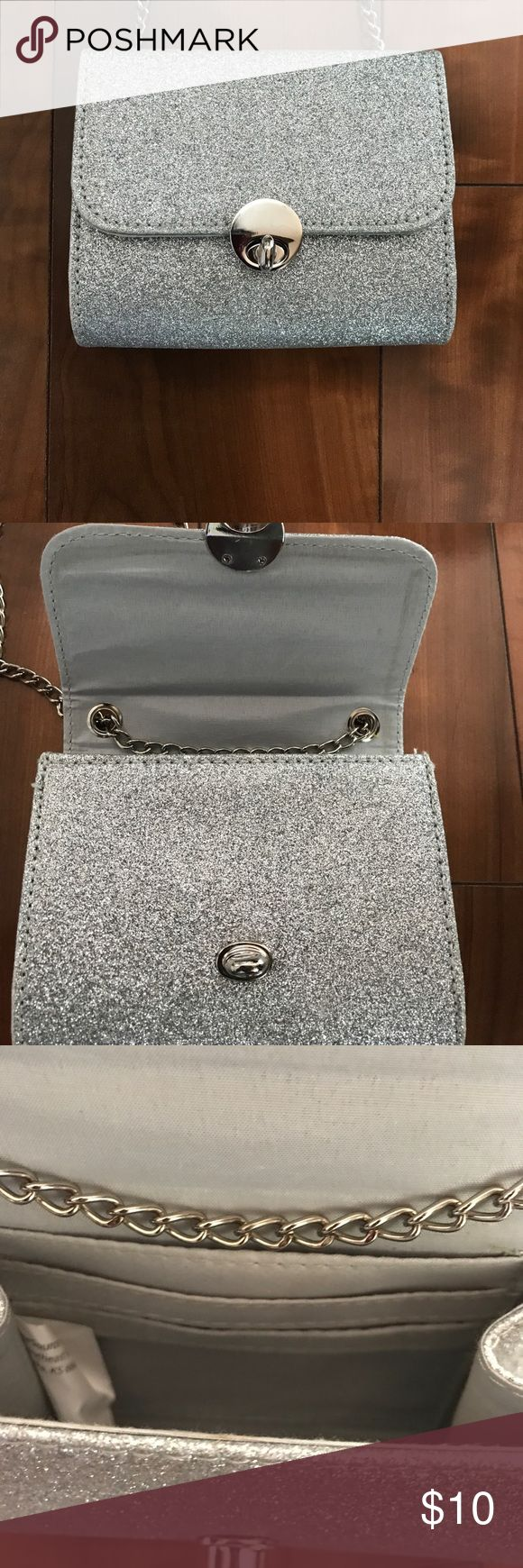 NWOT Shimmery petite crossbody purse 👛🎀💝 NWOT Cute and fun petite purse with silver shimmery exterior.  Chain link strap. Can be worn as crossbody, carried on arm or tuck the strap in and use as clutch. Purchased at Payless Shoe Source. Bags Crossbody Bags