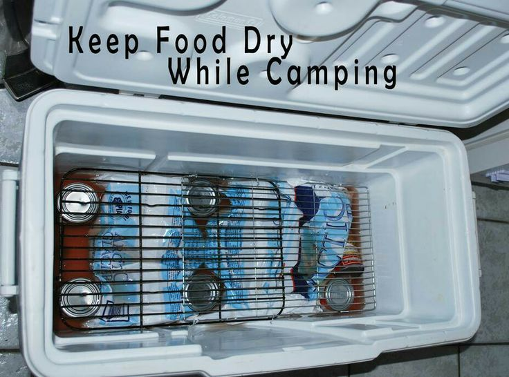 OMG, this is so obvious I feel like an IDIOT for not doing it beore. Keep food dry while camping - use baking racks to divide cooler