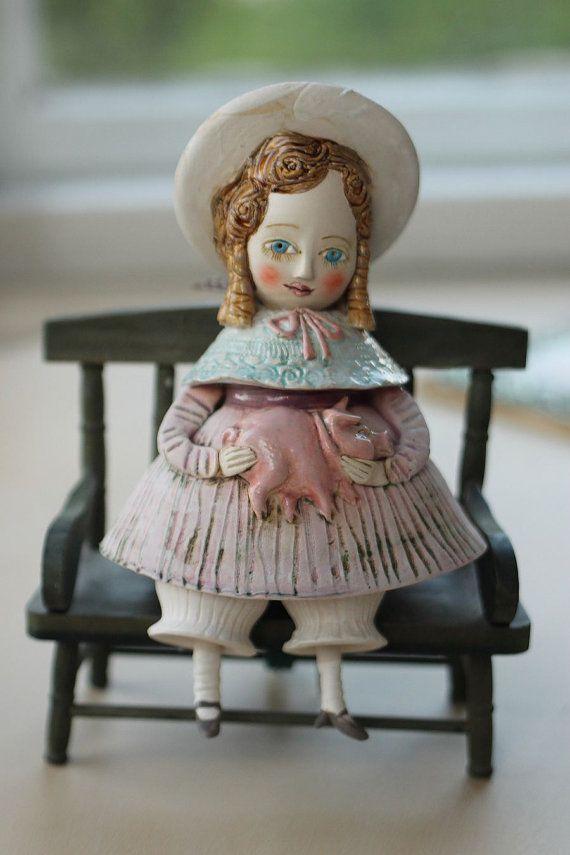 Vintage dressed girl holding a pig. Cute ceramic by yalonetski