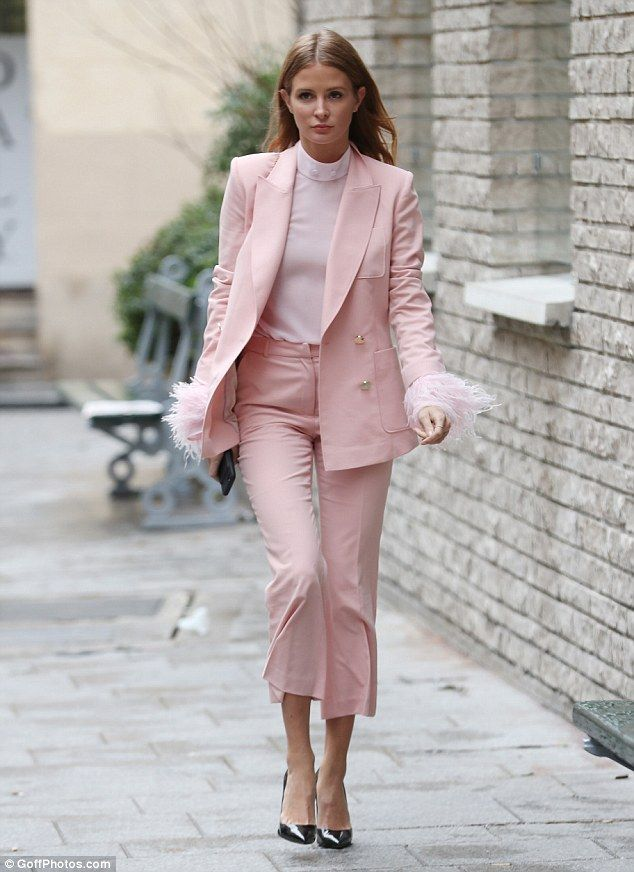 Sweet like candy! Millie Mackintosh struts her way to a meeting in Paris in a bubblegum pink power suit with feathered cuffs