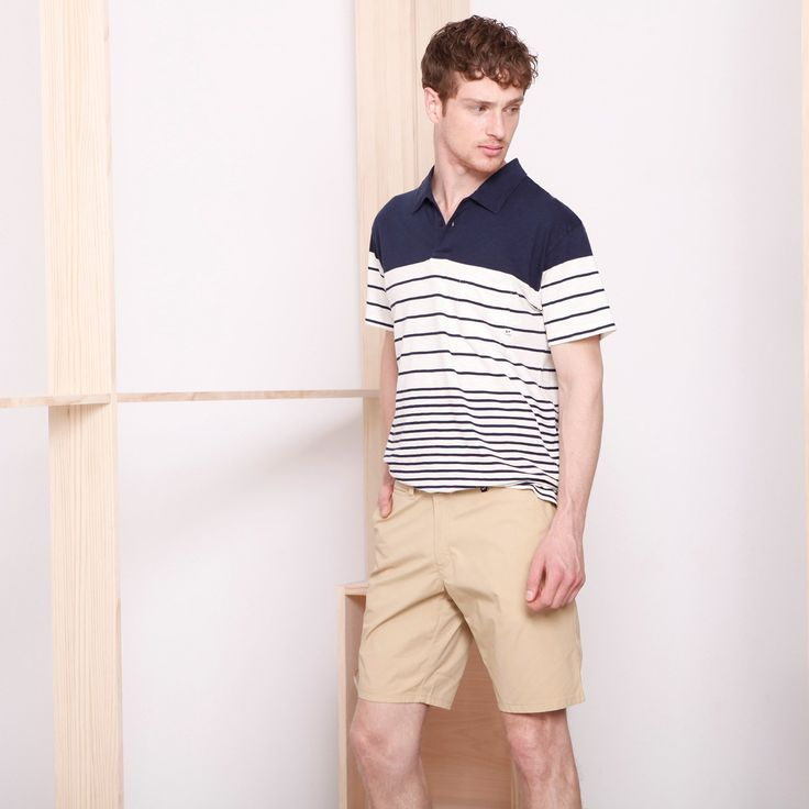 Portu Polo T-Shirt // 'Slub'-quality cotton polo shirt in a retro navy style with short-sleeve and navy-type opening neck with trimming on the original fabric. The stripe of the garment has been built or created on the fabric itself and features a plastron-style pocket in plain fabric in order to create some contrast with the horizontal shape of the stripe. The 'slub cotton' thread provides a cotton fabric with an irregular touch/look effect. Regular fit. Made in the EU.