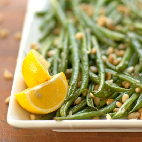 Green beans with toasted pine nuts, sautéed garlic, and bright tangy lemon juice