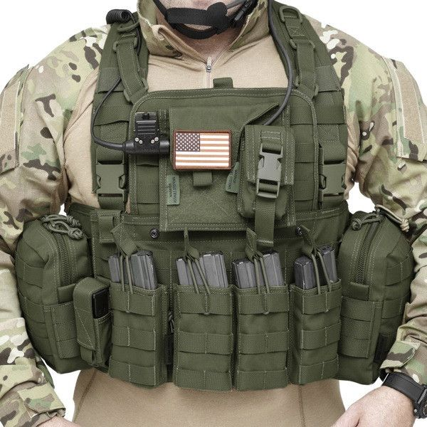 Awesome FRONT OPENING chest rig. Easy on, easy off and capable of holding hard armor.
