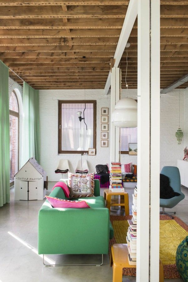 White Painted Brick, Exposed Wood Beam Ceiling, Full Length Mint Curtains, Mint Green Couch // unusual