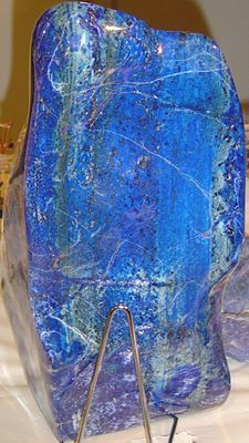 In ancient Egypt, lapis lazuli was a favorite stone for amulets and ornaments such as scarabs; it was also used in ancient Mesopotamia by the Sumerians, Akkadians, Assyrians, and Babylonians for seals and jewelry. In the Epic of Gilgamesh; the oldest known story in human history, lapis lazuli is referenced several times. Lapis jewelry has been found at excavations of the Predynastic Egyptian site Naqada (3300–3100 BC), and powdered lapis was used as eyeshadow by Cleopatra.