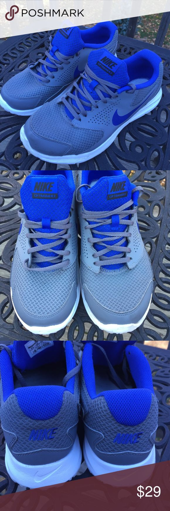 Nike Men's CP Trainer 2 Grey/Blue Sneakers 8.5 Nike Men's CP Trainer 2 sneakers. Size 8.5. Grey and Royal Blue. Really good condition. No trades Nike Shoes Athletic Shoes